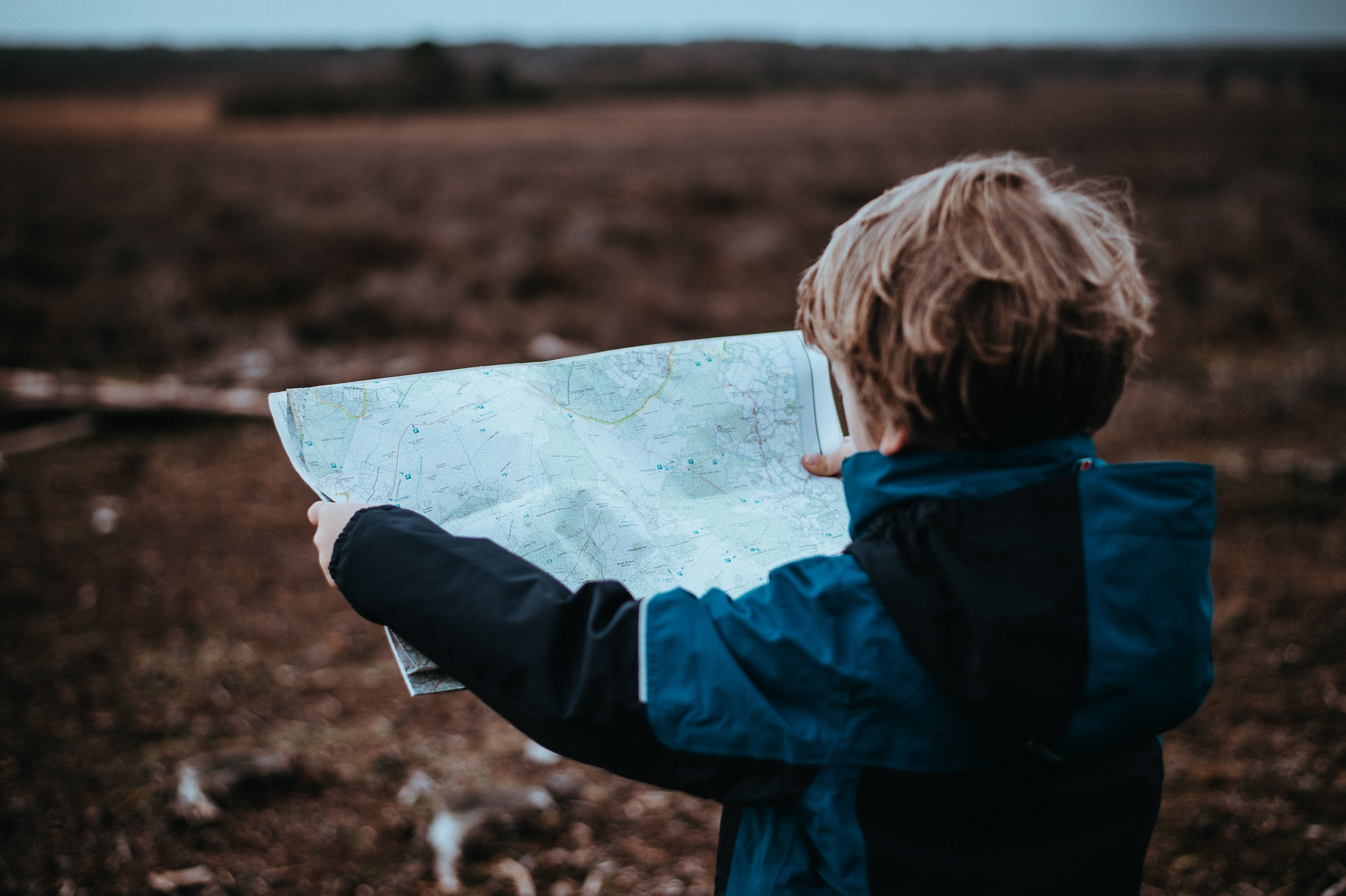 young boy holding a map