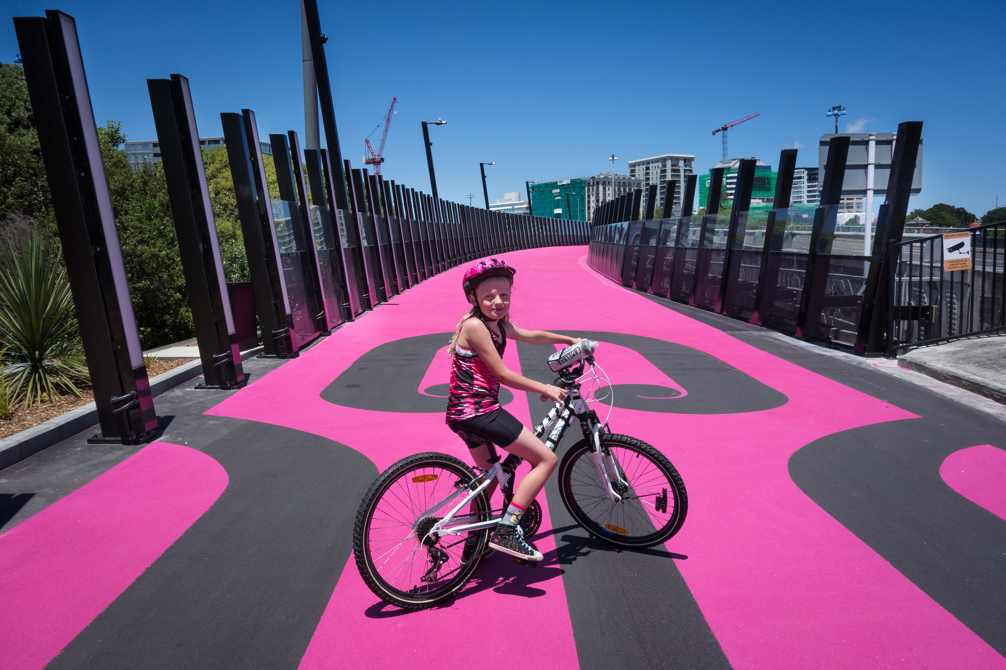 girl on bike on pink cycle path