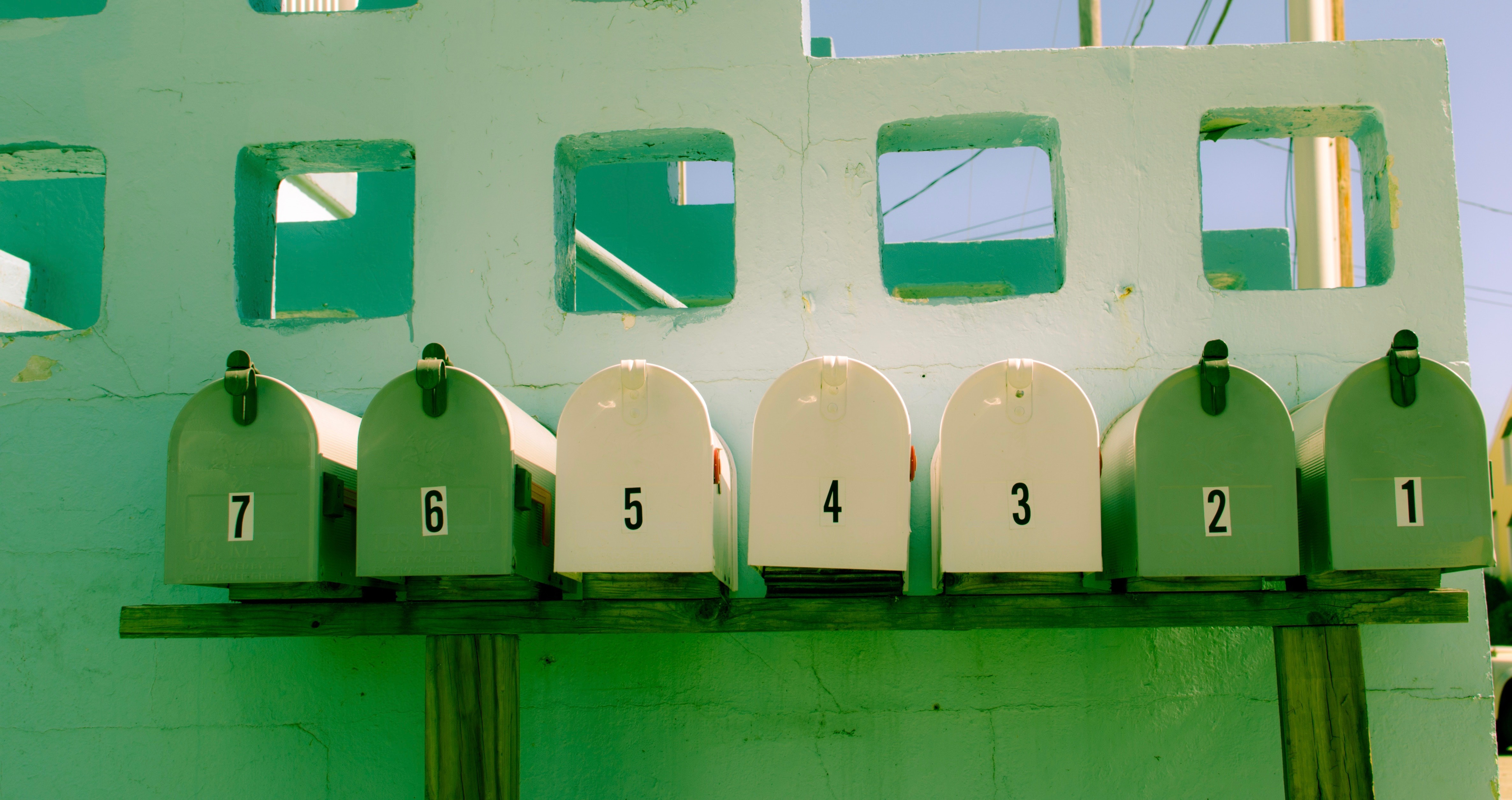 row of green letterboxes