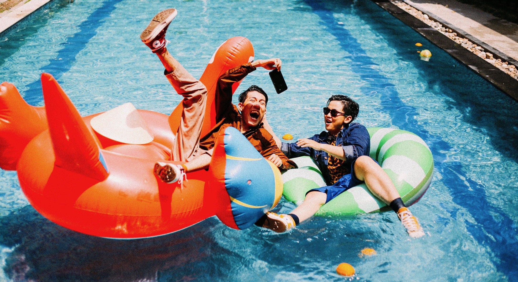 two guys on inflatable pool toys