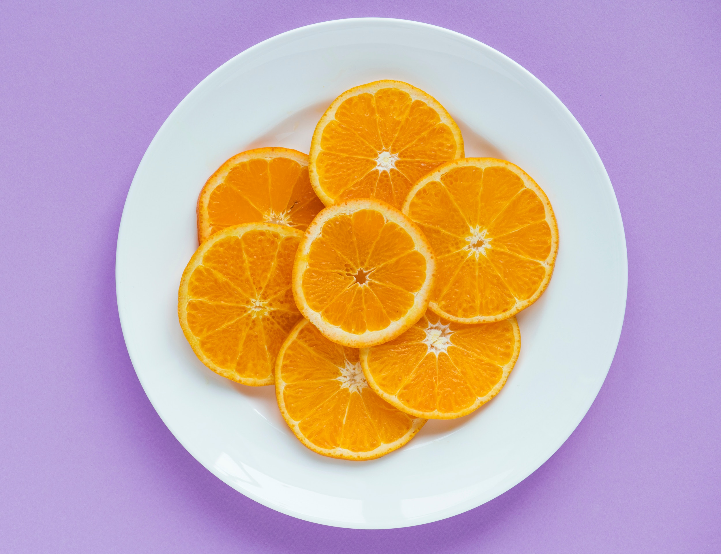 sliced oranges on a white plate