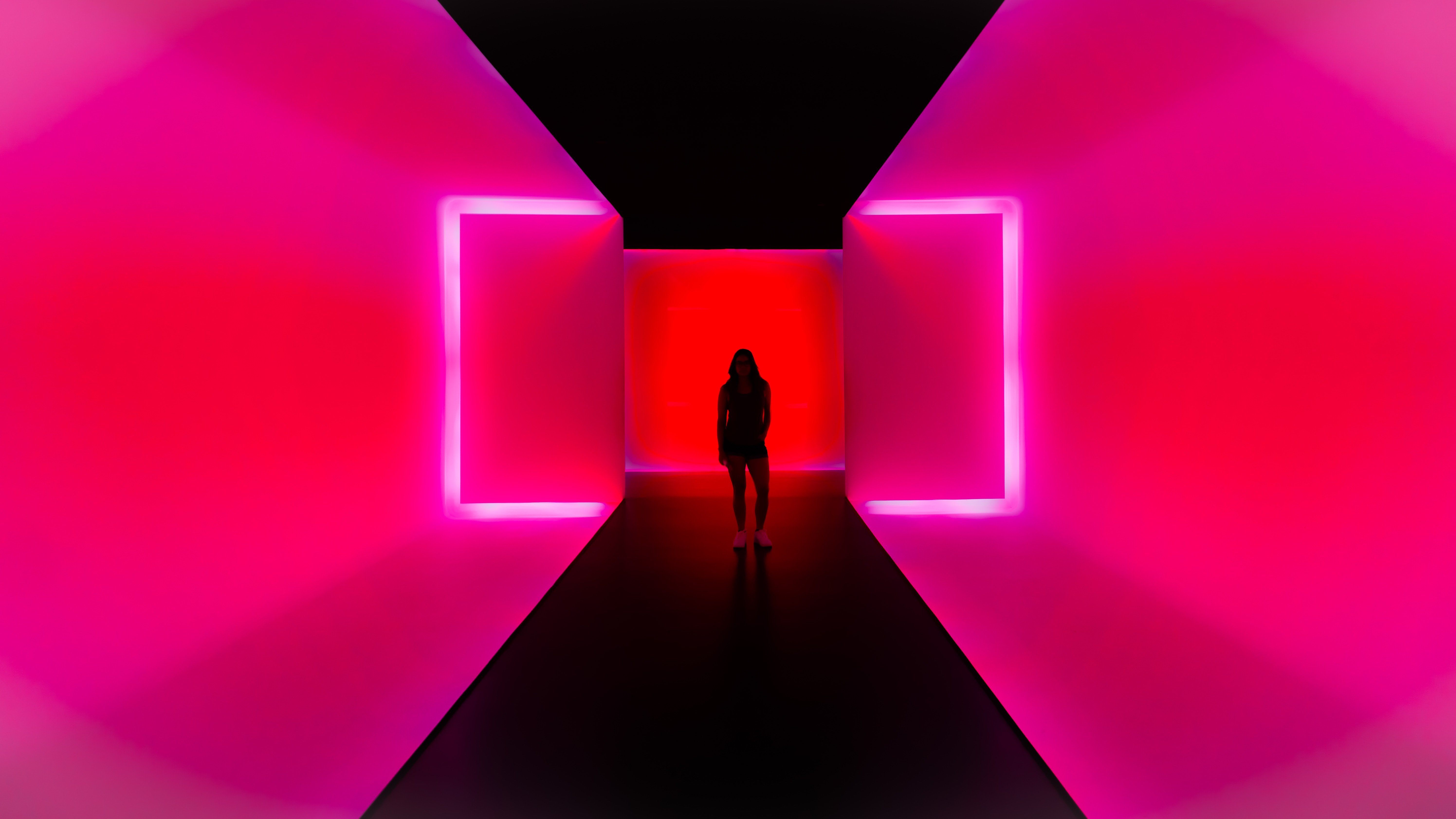 girl standing in pink room