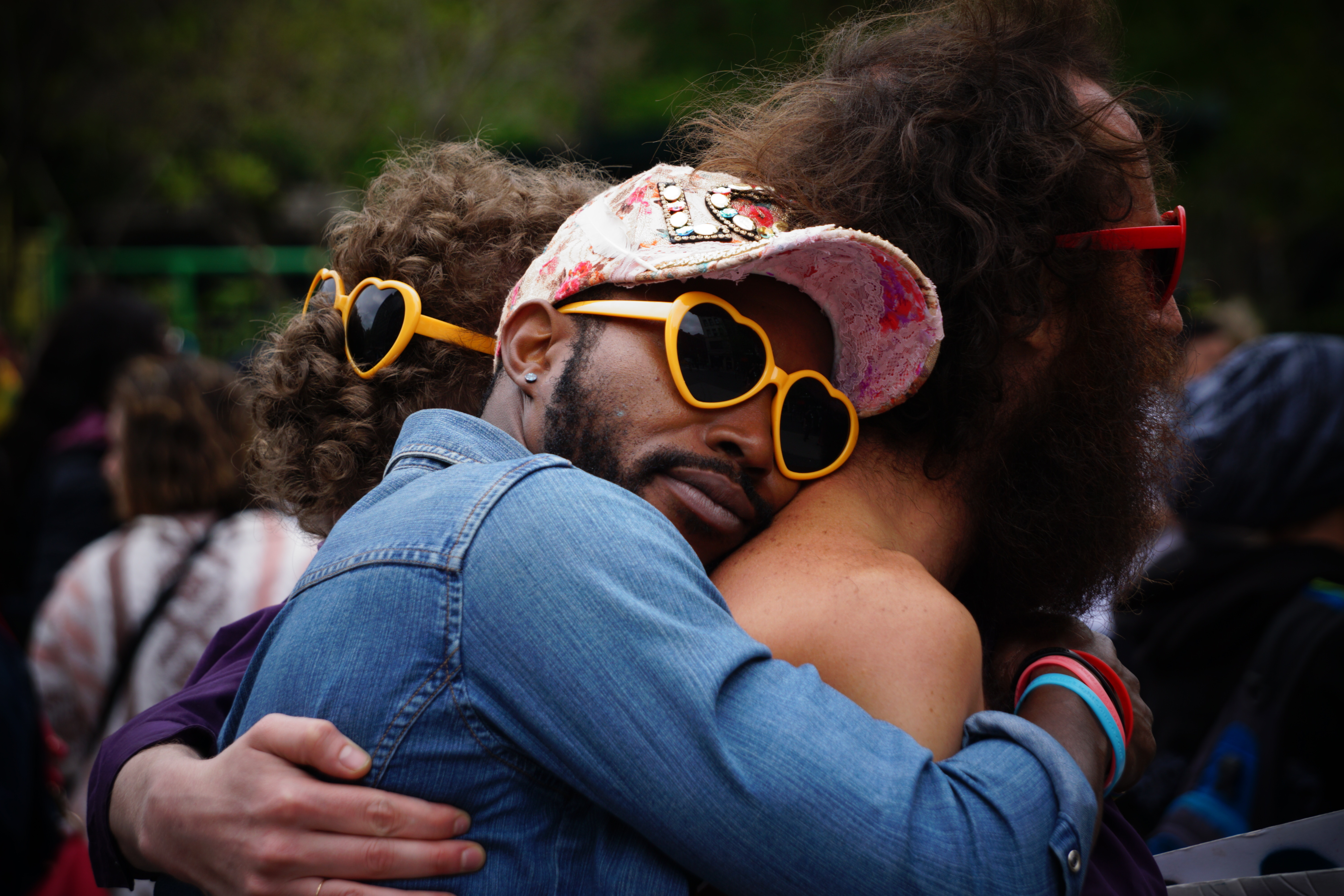 men hugging wearing yellow glasses