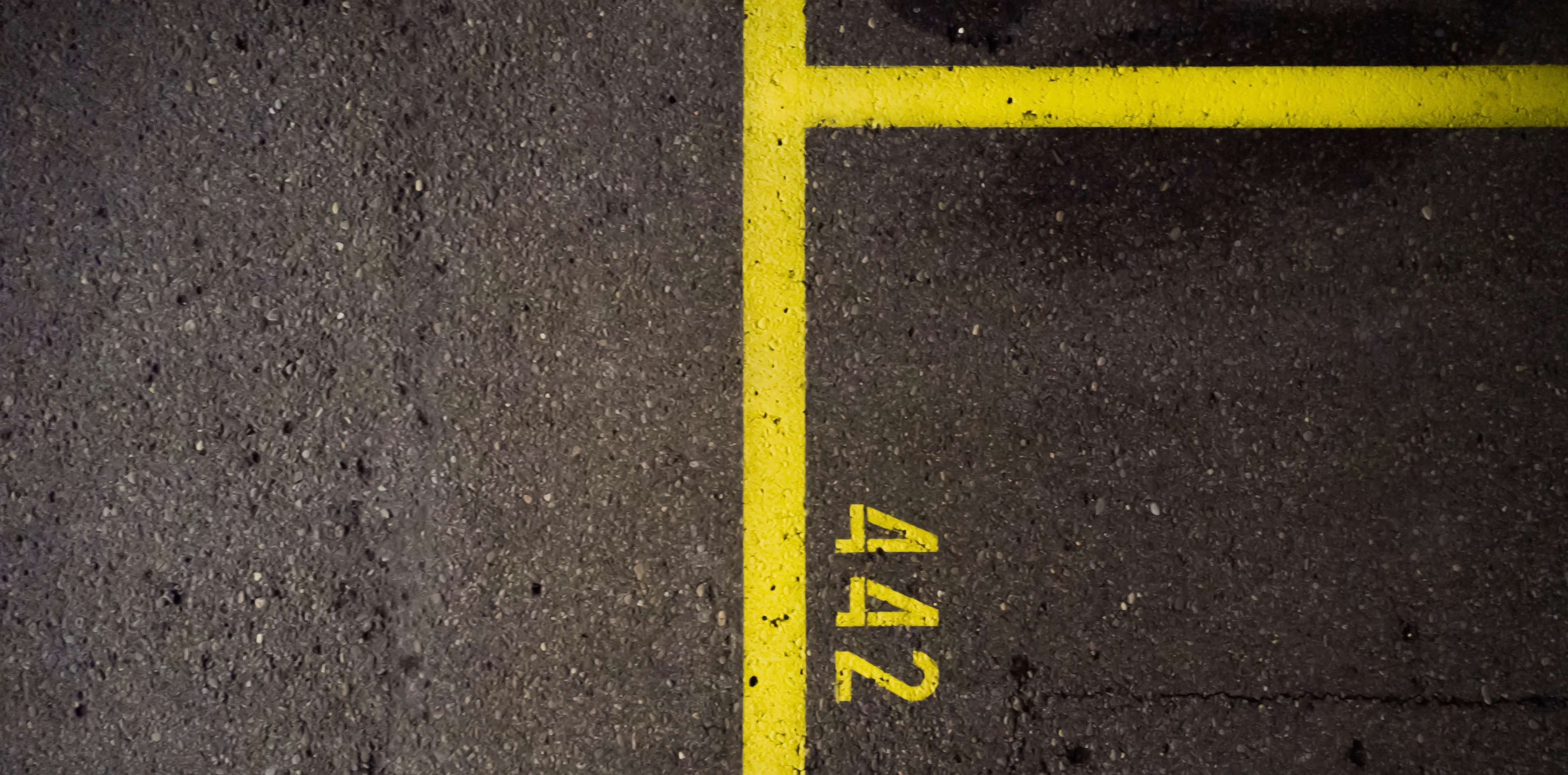carpark with yellow lines and numbers painted on