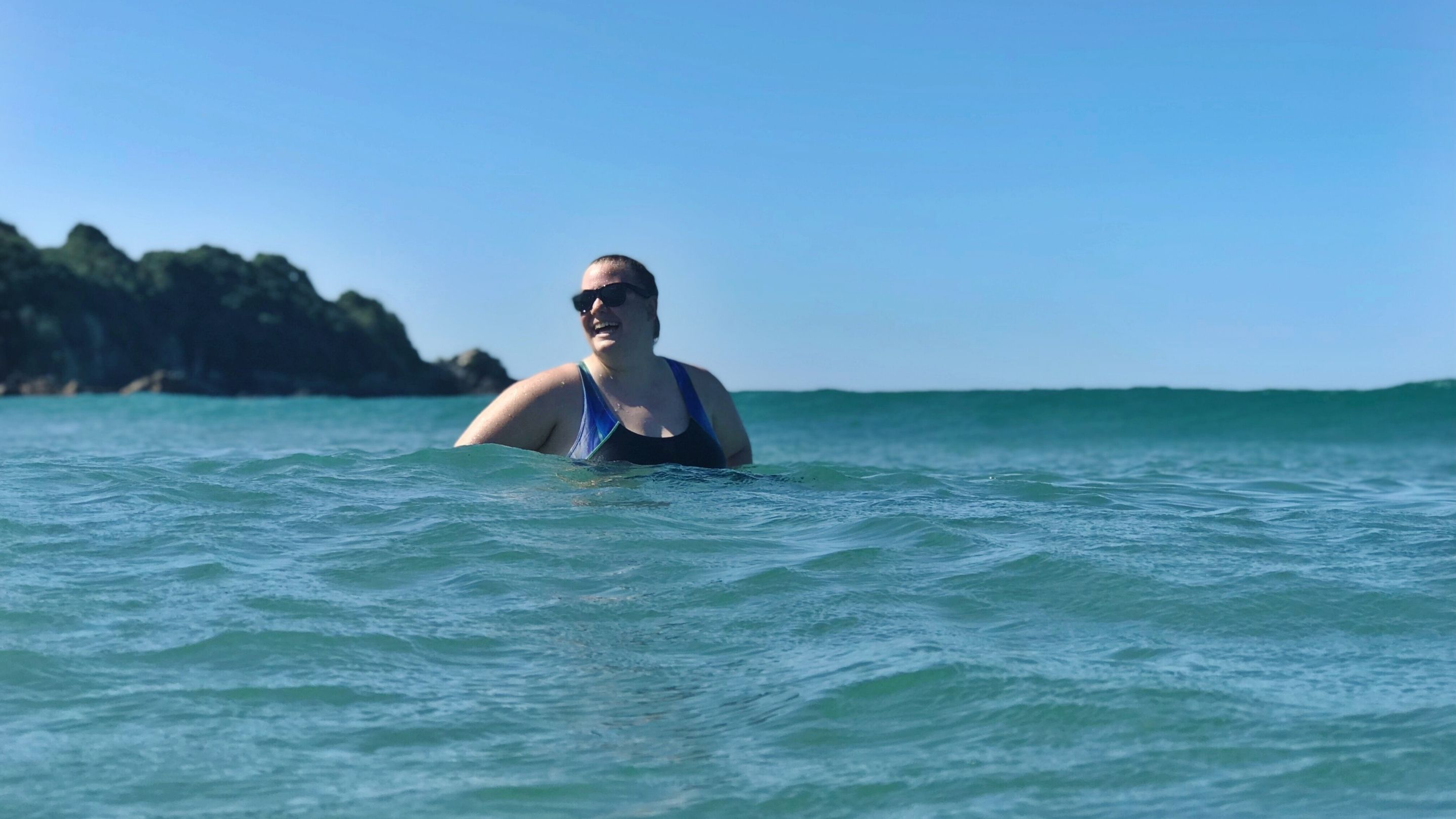 Photo of a woman swimming in New Zealand